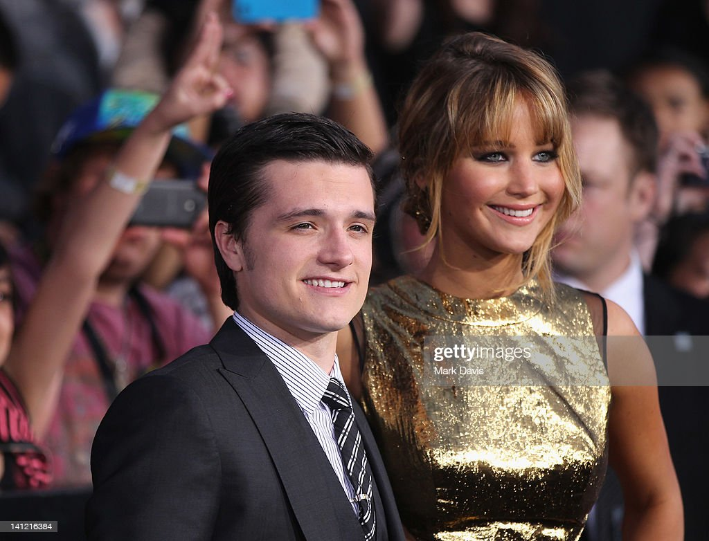 Actors <a gi-track='captionPersonalityLinkClicked' href=/galleries/search?phrase=Josh+Hutcherson&family=editorial&specificpeople=673588 ng-click='$event.stopPropagation()'>Josh Hutcherson</a> (L) and <a gi-track='captionPersonalityLinkClicked' href=/galleries/search?phrase=Jennifer+Lawrence&family=editorial&specificpeople=1596040 ng-click='$event.stopPropagation()'>Jennifer Lawrence</a> attend 'The Hunger Games' Los Angeles Premiere on March 12, 2012 in Los Angeles, California.