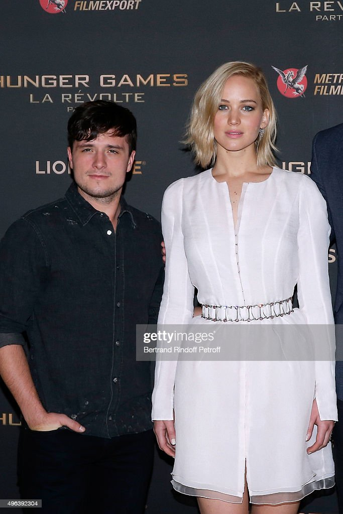 Actors Josh Hutcherson and Jennifer Lawrence makeup and dressed in Dior attend the 'Hunger Games Mockingjay Part 2' Paris Photocall at Plazza Athenee...