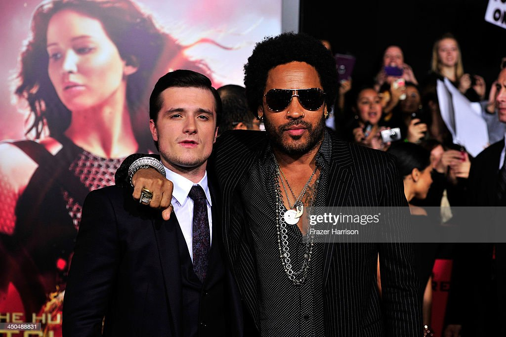 Actors Josh Hutcherson and Lenny Kravitz attend the premiere of Lionsgate's 'The Hunger Games: Cathching Fire' at Nokia Theatre L.A. Live on November 18, 2013 in Los Angeles, California.