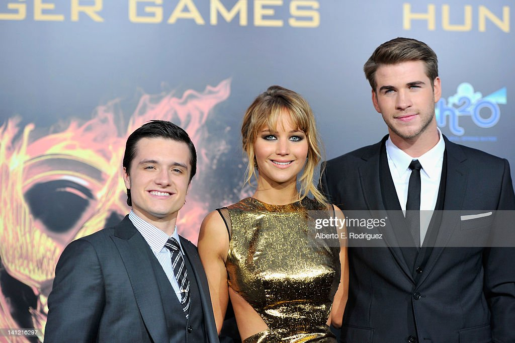 Actors <a gi-track='captionPersonalityLinkClicked' href=/galleries/search?phrase=Josh+Hutcherson&family=editorial&specificpeople=673588 ng-click='$event.stopPropagation()'>Josh Hutcherson</a>, <a gi-track='captionPersonalityLinkClicked' href=/galleries/search?phrase=Jennifer+Lawrence&family=editorial&specificpeople=1596040 ng-click='$event.stopPropagation()'>Jennifer Lawrence</a> and <a gi-track='captionPersonalityLinkClicked' href=/galleries/search?phrase=Liam+Hemsworth&family=editorial&specificpeople=6338547 ng-click='$event.stopPropagation()'>Liam Hemsworth</a> arrive to the premiere of Lionsgate's 'The Hunger Games' at Nokia Theatre L.A. Live on March 12, 2012 in Los Angeles, California.