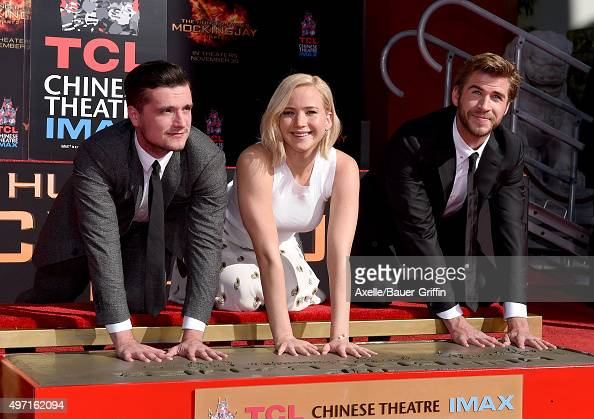 Actors Josh Hutcherson Jennifer Lawrence and Liam Hemsworth pose at 'The Hunger Games Mockingjay Part 2' Hand And Footprint Ceremony at TCL Chinese...