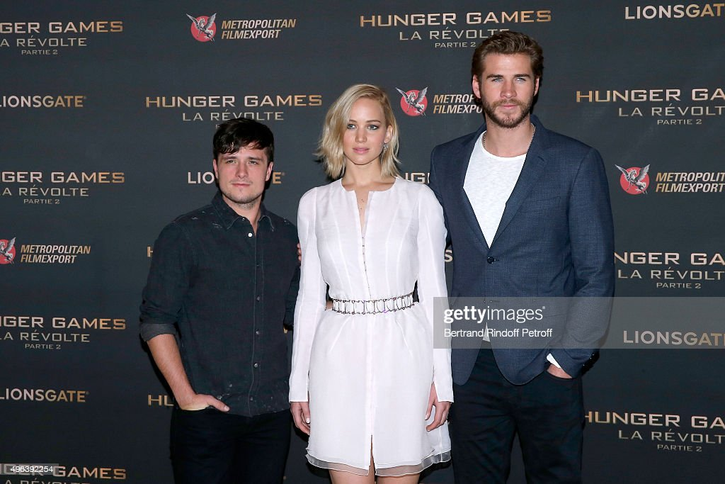 Actors Josh Hutcherson Jennifer Lawrence makeup and dressed in Dior and Liam Hemsworth attend the 'Hunger Games Mockingjay Part 2' Paris Photocall at...