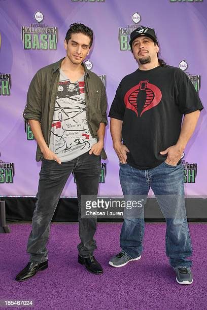 Actors Josh Keaton and Andrew Kishino arrive at Hub Network's 1st annual Halloween bash at Barker Hangar on October 20 2013 in Santa Monica California