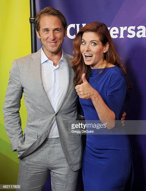 Actors Josh Lucas and Debra Messing arrive at the 2014 Television Critics Association Summer Press Tour NBCUniversal Day 1 at The Beverly Hilton...