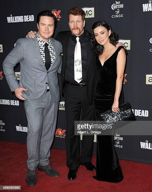 Actors Josh McDermitt Michael Cudlitz and Christian Serratos arrive for the Season 5 Premiere Of 'The Walking Dead' held at AMC Universal City Walk...