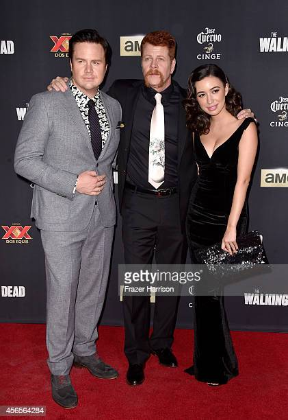 Actors Josh McDermitt Michael Cudlitz and Christian Serratos attend the season 5 premiere of 'The Walking Dead' at AMC Universal City Walk on October...