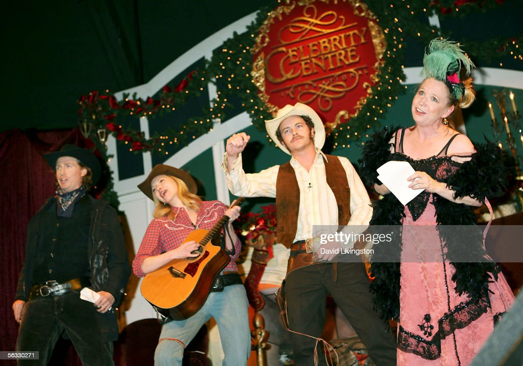 Actors Josh Meyers Laura Prepon Danny Masterson and Debra Jo Rupp perform on stage during the Church of Scientology's 'An Evening of Holiday Joy'...