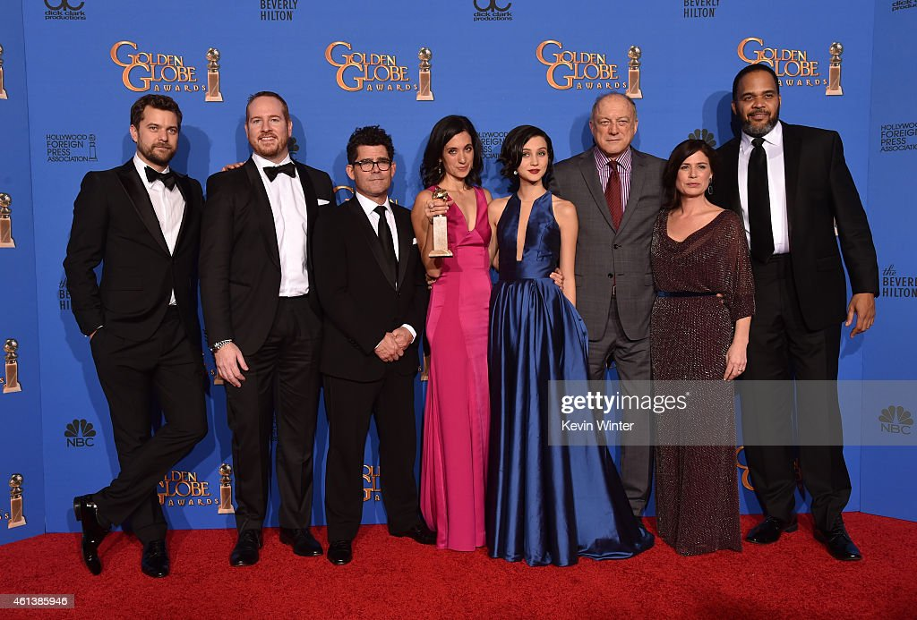 Actors Joshua Jackson, Darren Goldstein, writer/director Jeffrey Reiner, writer/producer Sarah Treem, actors Julia Goldani Telles, John Doman, Maura Tierney and Victor Williams, winners of the Best Drama Series Award for 'The Affair' pose in the press room during the 72nd Annual Golden Globe Awards at The Beverly Hilton Hotel on January 11, 2015 in Beverly Hills, California.