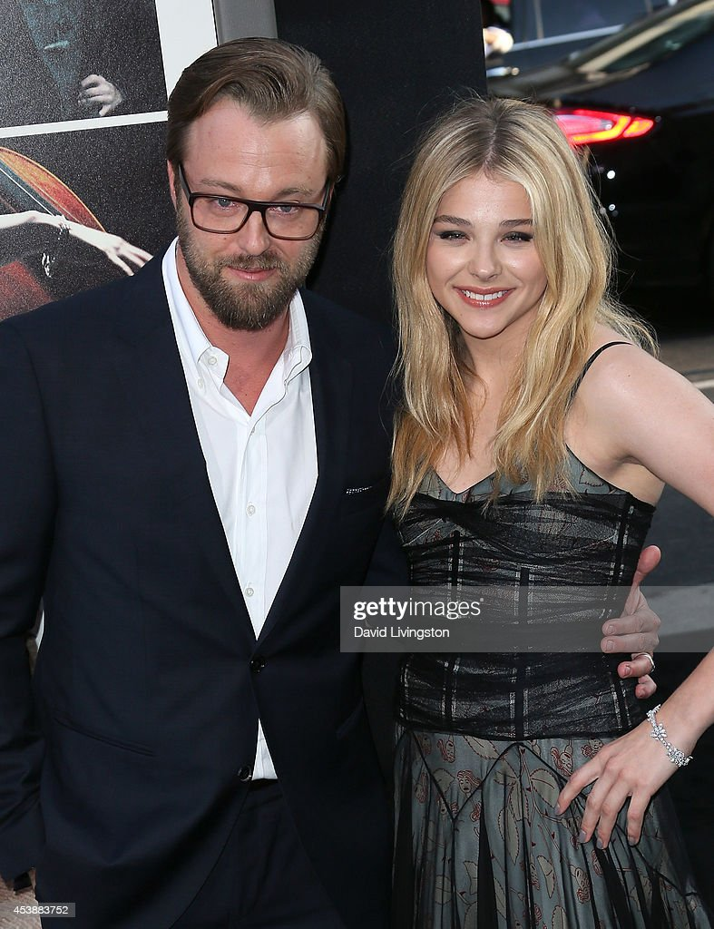 Actors <a gi-track='captionPersonalityLinkClicked' href=/galleries/search?phrase=Joshua+Leonard&family=editorial&specificpeople=240583 ng-click='$event.stopPropagation()'>Joshua Leonard</a> (L) and Chloe Grace Moretz attend the premiere of New Line Cinema's and Metro-Goldwyn-Mayer Pictures' 'If I Stay' at the TCL Chinese Theatre on August 20, 2014 in Hollywood, California.