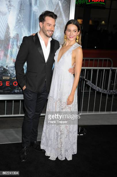 Actors Juan Pablo Espinosa and Julieth Restrepo attend the premiere of Warner Bros Pictures' 'Geostorm' on October 16 2017 at the TCL Chinese Theater...