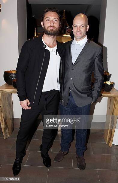 Actors Jude Law and Jonny Lee Miller attend an after party following Press Night of 'Anna Christie' at the Donmar Warehouse on August 9 2011 in...