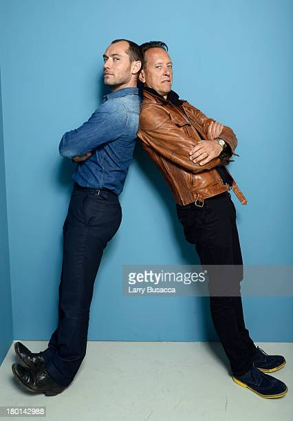 Actors Jude Law and Richard E Grant of 'Don Hemingway' pose at the Guess Portrait Studio during 2013 Toronto International Film Festival on September...