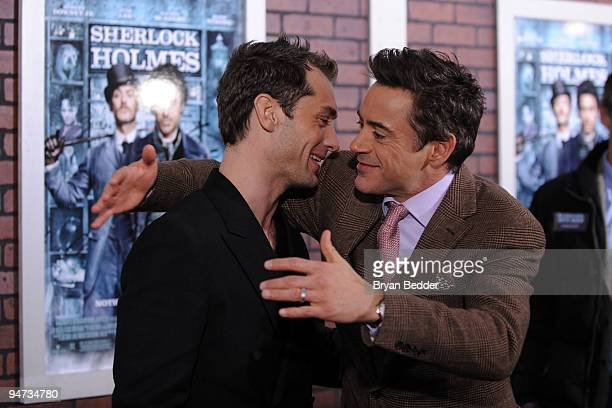 Actors Jude Law and Robert Downey Jr attend the premiere of 'Sherlock Holmes' at Alice Tully Hall Lincoln Center on December 17 2009 in New York City