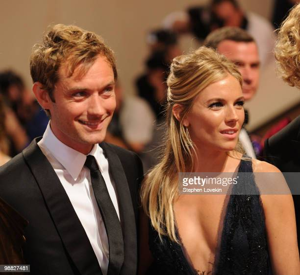Actors Jude Law and Sienna Miller attend the Costume Institute Gala Benefit to celebrate the opening of the 'American Woman Fashioning a National...
