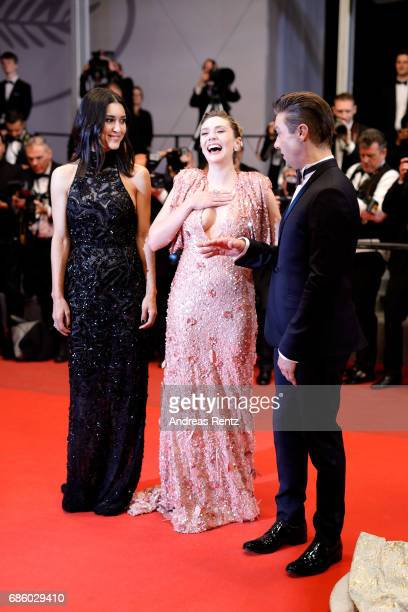 Actors Julia Jones Elizabeth Olsen and Jeremy Renner of 'Wind River' attend 'The Square' premiere during the 70th annual Cannes Film Festival at...
