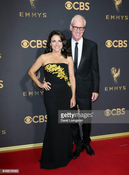 Actors Julia LouisDreyfus and Brad Hall attend the 69th Annual Primetime Emmy Awards Arrivals at Microsoft Theater on September 17 2017 in Los...