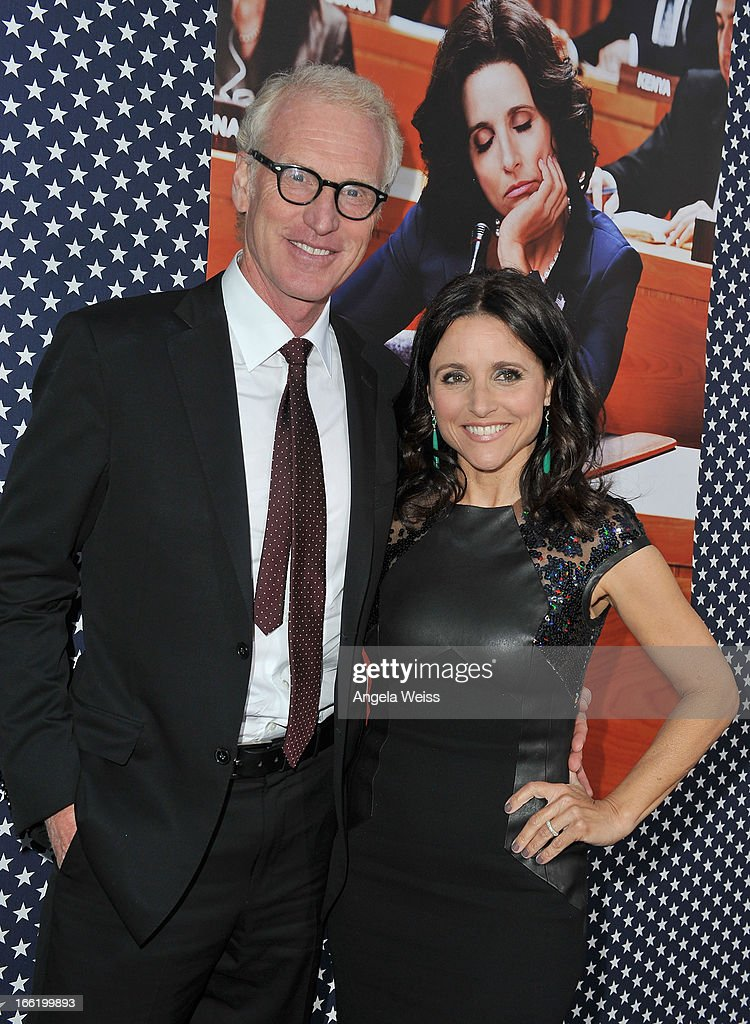 Actors Julia Louis-Dreyfus and her husband writer Brad Hall attend the Los Angeles premiere for the second season of HBO's series 'Veep' at Paramount Studios on April 9, 2013 in Hollywood, California.