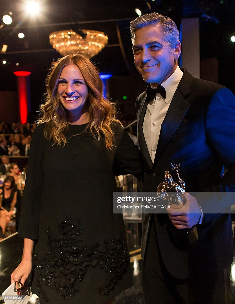Actors <a gi-track='captionPersonalityLinkClicked' href=/galleries/search?phrase=Julia+Roberts&family=editorial&specificpeople=202605 ng-click='$event.stopPropagation()'>Julia Roberts</a> (L) and <a gi-track='captionPersonalityLinkClicked' href=/galleries/search?phrase=George+Clooney&family=editorial&specificpeople=202529 ng-click='$event.stopPropagation()'>George Clooney</a> attend the 2013 BAFTA LA Jaguar Britannia Awards presented by BBC America at The Beverly Hilton Hotel on November 9, 2013 in Beverly Hills, California.