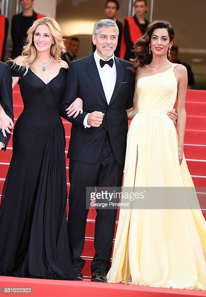 Actors Julia Roberts George Clooney and his wife Amal Clooney attend the screening of 'Money Monster' at the annual 69th Cannes Film Festival at...