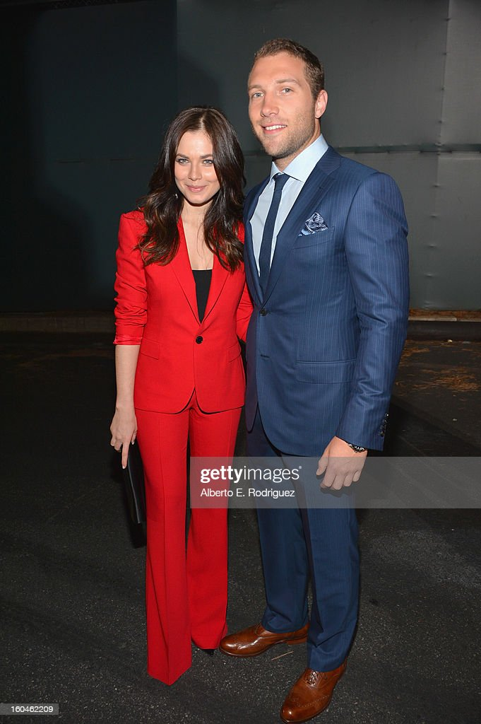 Actors Julia Snigir and Jai Courtney attend the dedication and unveiling of a new soundstage mural celebrating 25 years of 'Die Hard' at Fox Studio Lot on January 31, 2013 in Century City, California.
