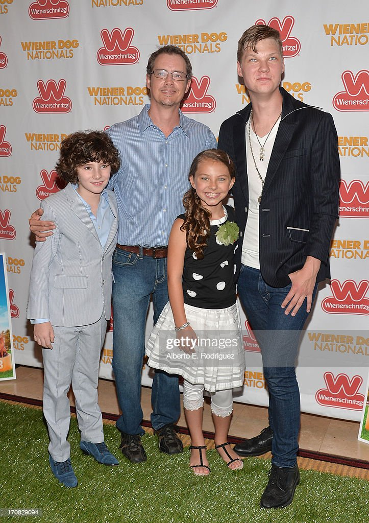 Actors Julian Feder, Jason London, Caitlin Carmichael and Ausitn Anderson arrive to the Premiere of 'Wiener Dog Nationals' at Pacific Theatre at The Grove on June 18, 2013 in Los Angeles, California.