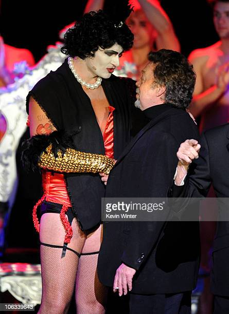 Actors Julian McMahon and Tim Curry perform onstage during The Rocky Horror Picture Show 35th anniversary to benefit The Painted Turtle at The...