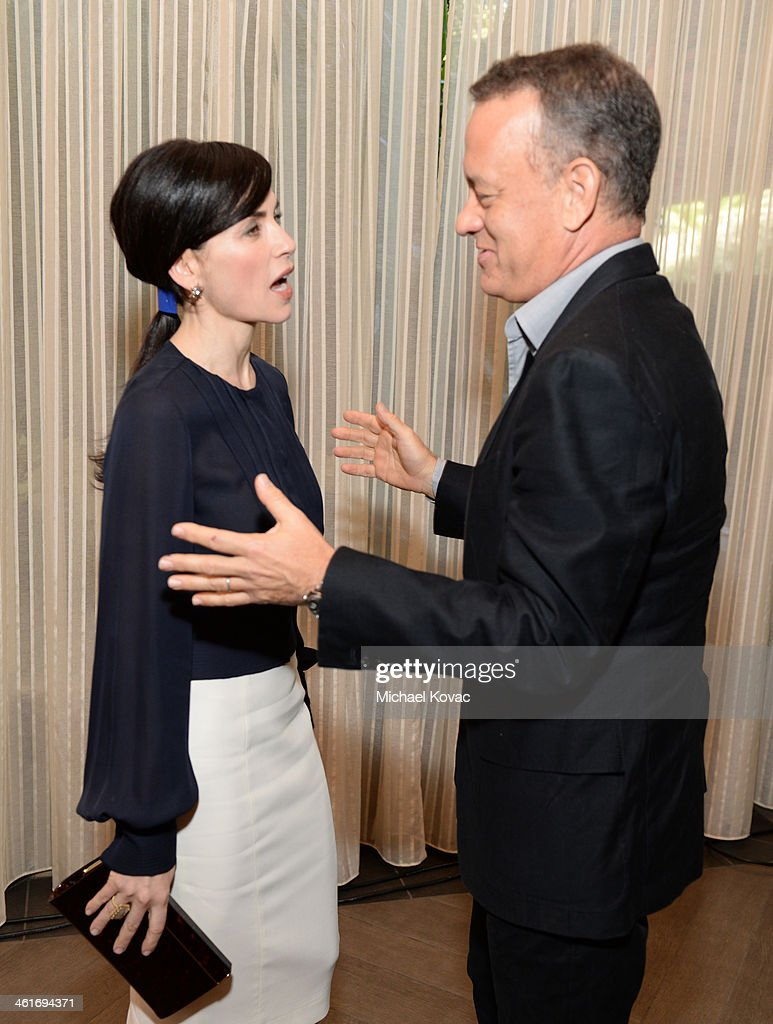 Actors Julianna Margulies and <a gi-track='captionPersonalityLinkClicked' href=/galleries/search?phrase=Tom+Hanks&family=editorial&specificpeople=201790 ng-click='$event.stopPropagation()'>Tom Hanks</a> attend the 14th annual AFI Awards Luncheon at the Four Seasons Hotel Beverly Hills on January 10, 2014 in Beverly Hills, California.