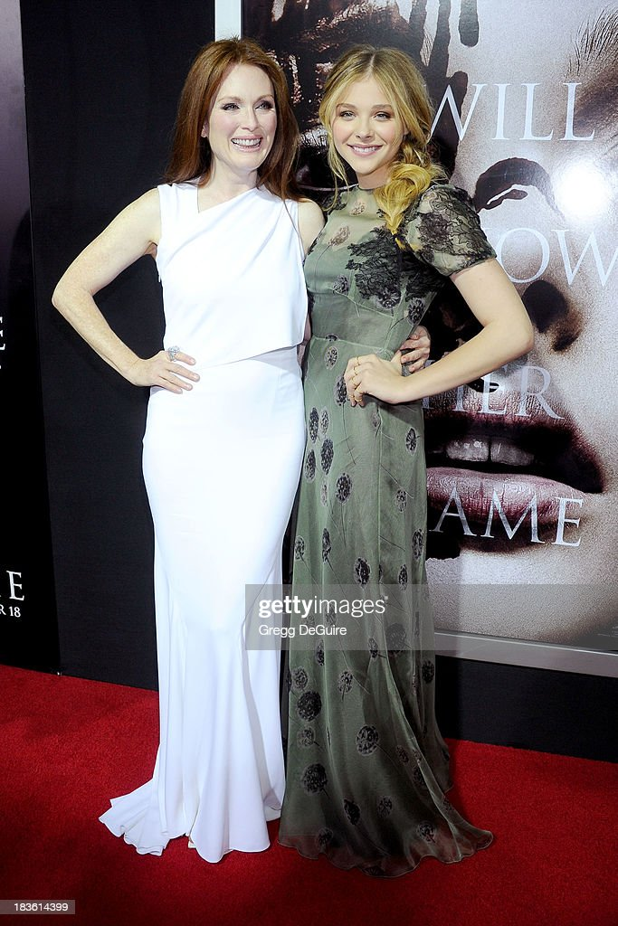 Actors <a gi-track='captionPersonalityLinkClicked' href=/galleries/search?phrase=Julianne+Moore&family=editorial&specificpeople=171555 ng-click='$event.stopPropagation()'>Julianne Moore</a> and Chloe Grace Moretz arrive at the Los Angeles premiere of 'Carrie' at ArcLight Hollywood on October 7, 2013 in Hollywood, California.