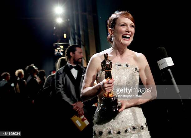 Actors Julianne Moore winner of Best Actress for 'Still Alice' and Matthew McConaughey attend the 87th Annual Academy Awards at Dolby Theatre on...