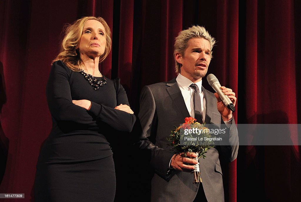 Actors <a gi-track='captionPersonalityLinkClicked' href=/galleries/search?phrase=Julie+Delpy&family=editorial&specificpeople=201914 ng-click='$event.stopPropagation()'>Julie Delpy</a> and <a gi-track='captionPersonalityLinkClicked' href=/galleries/search?phrase=Ethan+Hawke&family=editorial&specificpeople=178274 ng-click='$event.stopPropagation()'>Ethan Hawke</a> appear on stage after the 'Before Midnight' Premiere during the 63rd Berlinale International Film Festival at the Berlinale Palast on February 11, 2013 in Berlin, Germany.