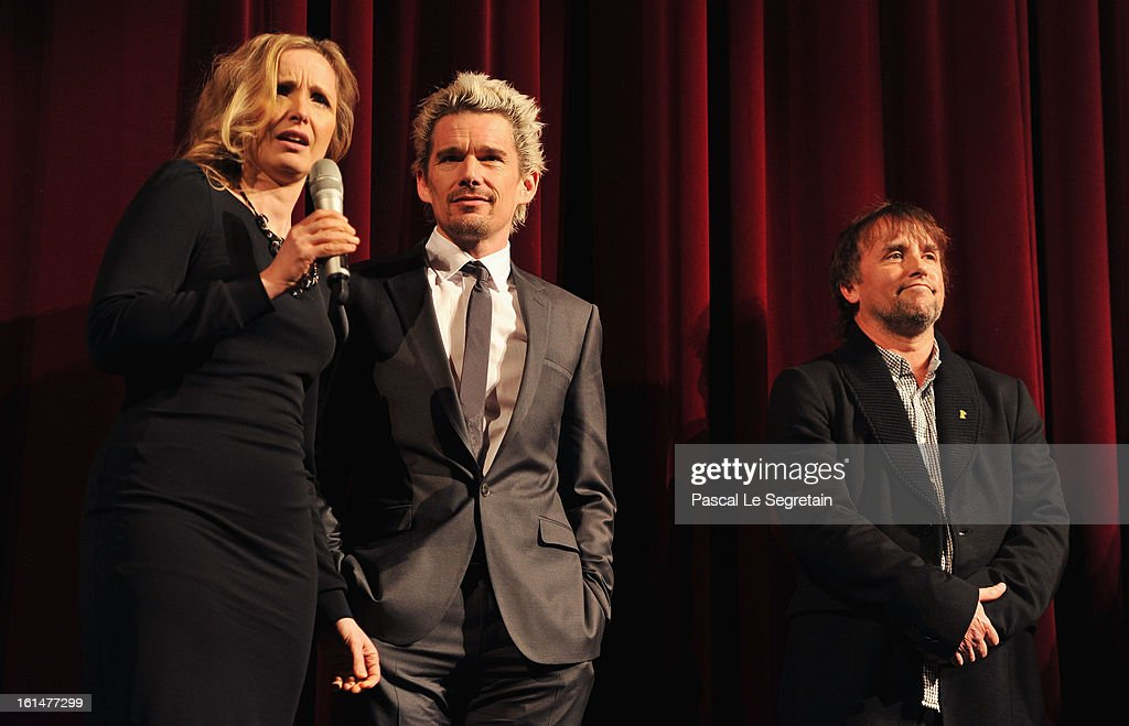 Actors Julie Delpy, Ethan Hawke and director Richard Linklater appear on stage after the 'Before Midnight' Premiere during the 63rd Berlinale International Film Festival at the Berlinale Palast on February 11, 2013 in Berlin, Germany.