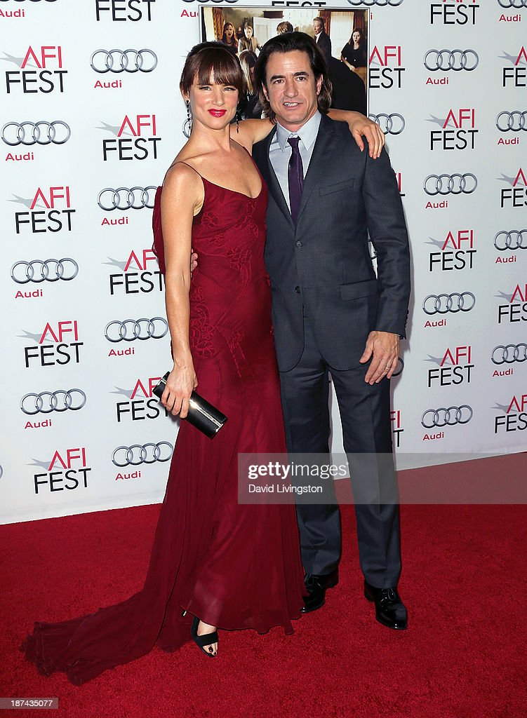 Actors Juliette Lewis (L) and Dermot Mulroney attend the AFI FEST 2013 presented by Audi premiere of The Weinstein Company's 'August: Osage County' at the TCL Chinese Theatre on November 8, 2013 in Hollywood, California.