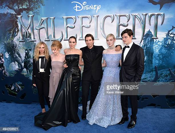 Actors Juno Temple Lesley Manville Angelina Jolie Sharlto Copley Elle Fanning and Sam Riley attend the World Premiere of Disney's 'Maleficent' at the...