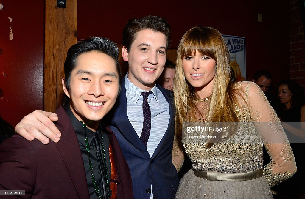 Actors Justin Chon Miles Teller and Sarah Wright attend Relativity Media's '21 and Over' premiere after party at Westwood Brewing Co on February 21...