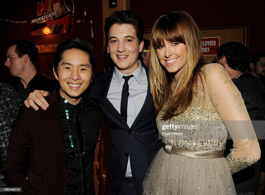 Actors Justin Chon Miles Teller and Sarah Wright pose at the after party for the premiere of Relativity Media's '21 And Over' at the Westwood Brewery...