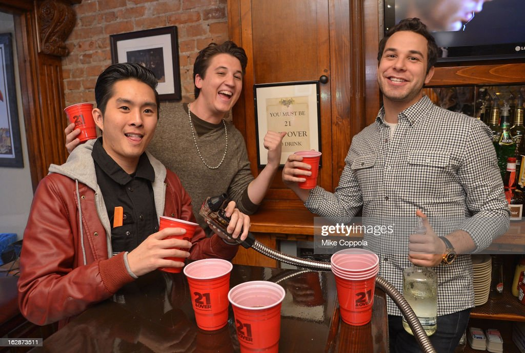 Actors Justin Chon, Miles Teller, and Skylar Astin attend the '21 & Over' Press Call at Playwrights Tavern on February 28, 2013 in New York City.
