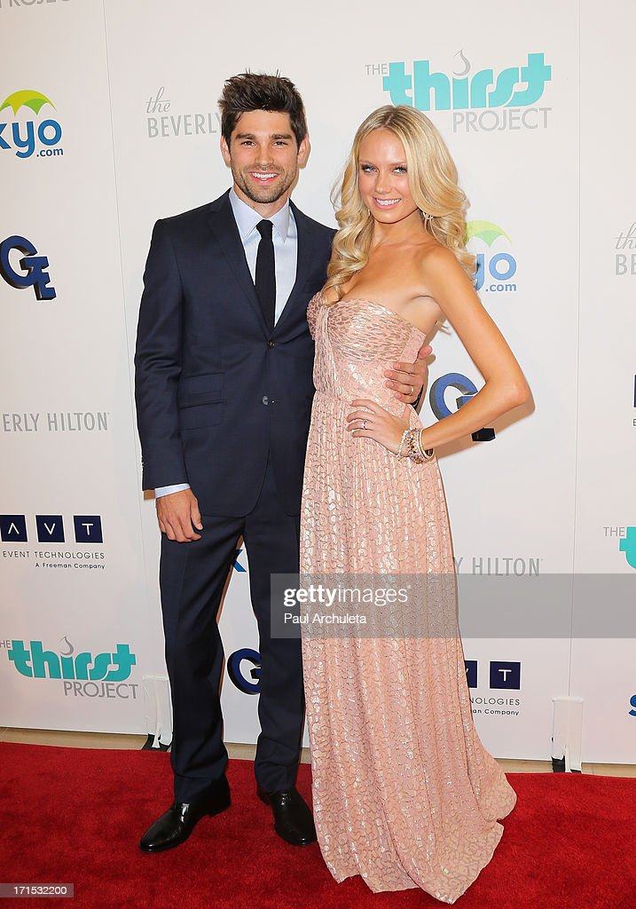 Actors Justin Gaston (L) and Melissa Ordway (R) attend the 4th annual Thirst Gala at The Beverly Hilton Hotel on June 25, 2013 in Beverly Hills, California.