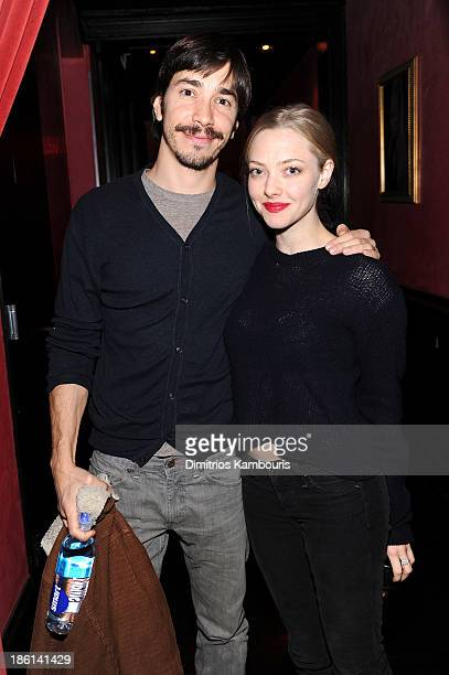 Actors Justin Long and Amanda Seyfried attend LAByrinth Theater Company Celebrity Charades 2013 Benefit Gala on October 28 2013 in New York City