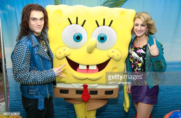 Actors Justin Matthew Sargent and Tessa Alves of rock of Ages attend the Norwegian Warming Station launch in Times Square on January 28 2013 in New...