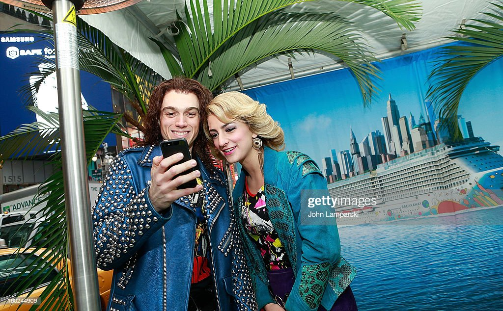 Actors Justin Matthew Sargent and Tessa Alves of rock of Ages attend the Norwegian Warming Station launch in Times Square on January 28, 2013 in New York City.