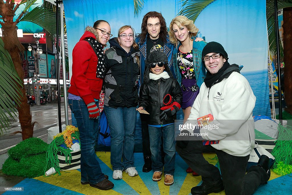 Actors Justin Matthew Sargent,Tessa Alves of rock of Ages and contest winners attend the Norwegian Warming Station launch in Times Square on January 28, 2013 in New York City.