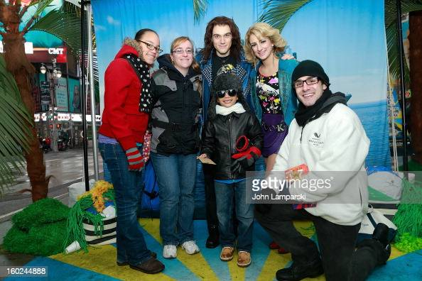 Actors Justin Matthew SargentTessa Alves of rock of Ages and contest winners attend the Norwegian Warming Station launch in Times Square on January...