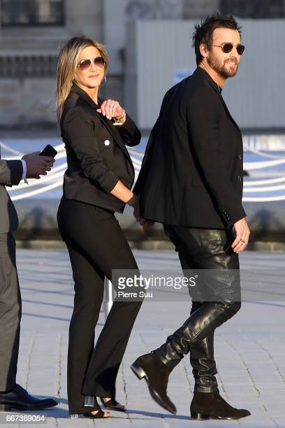 Actors Justin Theroux and his wife Jennifer Aniston arrive at the Louis Vuitton's Dinner for the Launch of Bags by Artist Jeff Koons at Musee du...