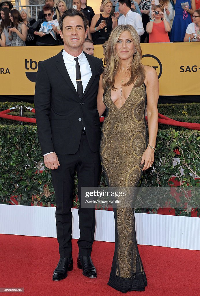 Actors Justin Theroux and Jennifer Aniston arrive at the 21st Annual Screen Actors Guild Awards at The Shrine Auditorium on January 25, 2015 in Los Angeles, California.