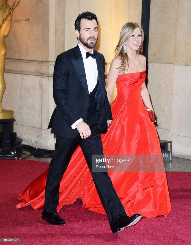 Actors Justin Theroux and Jennifer Aniston depart the Oscars at Hollywood & Highland Center on February 24, 2013 in Hollywood, California.