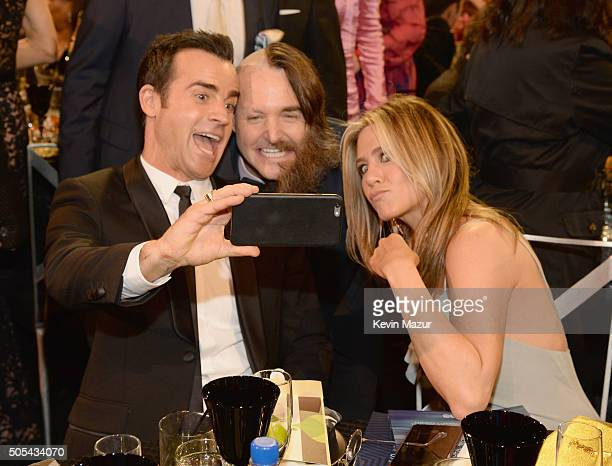 Actors Justin Theroux Will Forte and Jennifer Aniston take a selfie during the 21st Annual Critics' Choice Awards at Barker Hangar on January 17 2016...