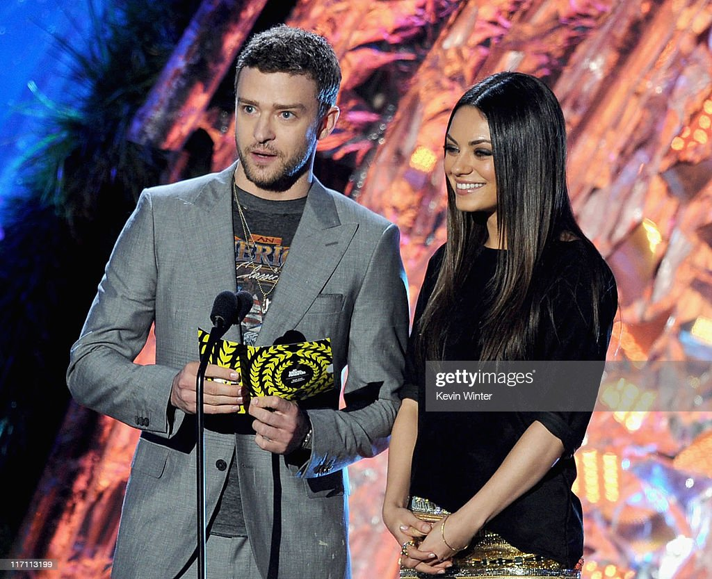 Actors Justin Timberlake (L) and Mila Kunis present an award onstage during the 2011 MTV Movie Awards at Universal Studios' Gibson Amphitheatre on June 5, 2011 in Universal City, California.
