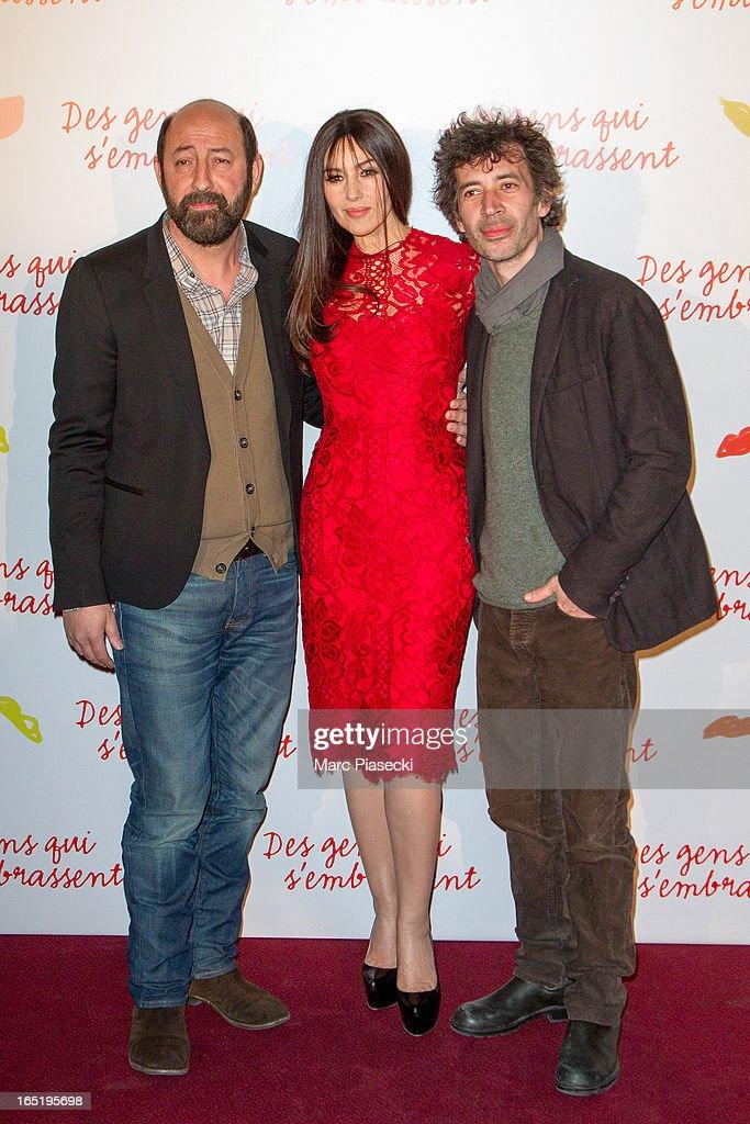 Actors Kad Merad, Monica Bellucci and Eric Elmosnino attend the 'Des Gens Qui S'embrassent' Premiere at Cinema Gaumont Marignan on April 1, 2013 in Paris, France.