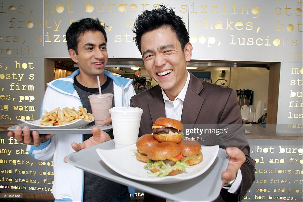 Actors Kal Penn and John Cho poses for a portrait while promoting their movie 'Harold and Kumar Go To White Castle' at Pop's Burger in downtown New York City on July 19, 2004.