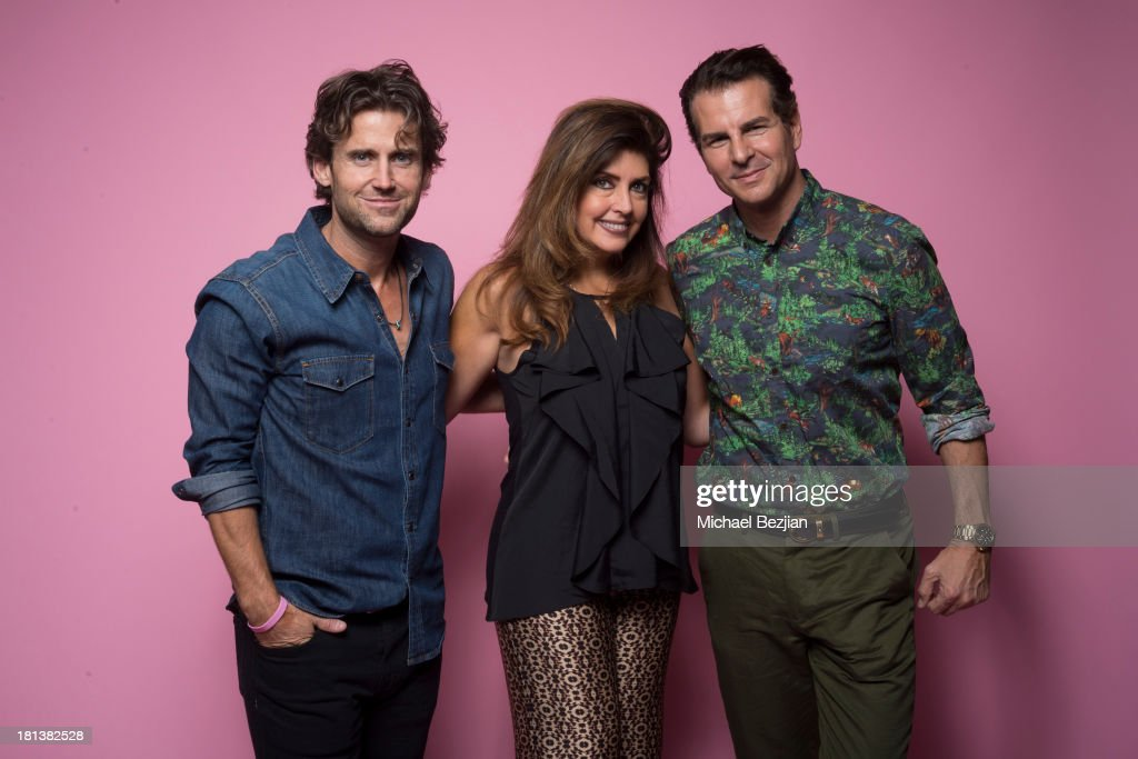 Actors Kale Flowers and Vincent De Paul (R) pose with Elizabeth Webster (C) at the Mark Kearney Group - 'Iced Out' Luxury Emmy Suite on September 20, 2013 in Los Angeles, California.